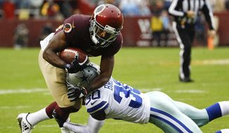 Washington Redskins wide receiver Jamison Crowder (80) is stopped by Dallas Cowboys cornerback Anthony Brown (30) during the first half of an NFL football game in Landover, Md., Sunday, Oct. 29, 2017. (AP Photo/Patrick Semansky)