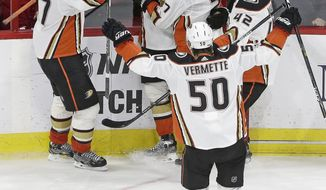 Anaheim Ducks' Jakob Silfverberg (33), of Sweden, is congratulated following his goal against the Carolina Hurricanes by Hampus Lindholm (47), of Sweden, Josh Manson (42), Andrew Cogliano (7) and Antoine Vermette during the third period of an NHL hockey game in Raleigh, N.C., Sunday, Oct. 29, 2017. Anaheim won 4-3 in a shootout. (AP Photo/Gerry Broome)