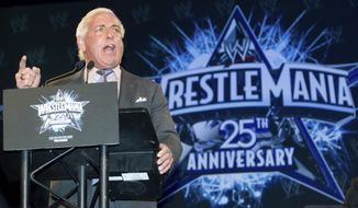"FILE - In this March 31, 2009, file photo, wrestler Ric Flair attends the 25th Anniversary of WrestleMania press conference at the Hard Rock Cafe in New York. Flair, whose ""Wooooooo!"" call during promos and matches became one of the most imitated catchphrases in sports, thought he would die. Alive, and with a new lease on life, Flair tells The Associated Press he's done drinking and vows to clean up his act with whatever time he has left. (AP Photo/Charles Sykes, File)"
