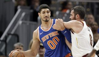 New York Knicks' Enes Kanter, left, drives past Cleveland Cavaliers' Kevin Love in the first half of an NBA basketball game, Sunday, Oct. 29, 2017, in Cleveland. (AP Photo/Tony Dejak) **FILE**