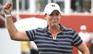 Cristie Kerr of the United States celebrates after winning the Sime Darby LPGA golf tournament at Tournament Players Club (TPC) in Kuala Lumpur, Malaysia, Sunday, Oct. 29, 2017. (AP Photo/Sadiq Asyraf)