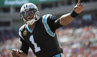 Carolina Panthers quarterback Cam Newton (1) celebrates a 1-yard touchdown run by running back Jonathan Stewart against the Tampa Bay Buccaneers during the first quarter of an NFL football game Sunday, Oct. 29, 2017, in Tampa, Fla. (AP Photo/Phelan Ebenhack)