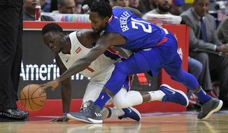 Detroit Pistons guard Reggie Jackson, of Italy,, left, and Los Angeles Clippers guard Patrick Beverley go after a loose ball during the first half of an NBA basketball game, Saturday, Oct. 28, 2017, in Los Angeles. (AP Photo/Mark J. Terrill)