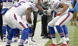 Buffalo Bills quarterback Tyrod Taylor (5) and quarterback Joe Webb (14) celebrate after they connected on a touchdown pass against the Oakland Raiders during the first half of an NFL football game, Sunday, Oct. 29, 2017, in Orchard Park, N.J. (AP Photo/Adrian Kraus)