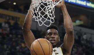 Indiana Pacers' Thaddeus Young dunks during the first half of an NBA basketball game against the San Antonio Spurs, Sunday, Oct. 29, 2017, in Indianapolis. (AP Photo/Darron Cummings)