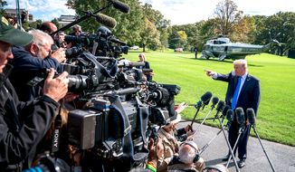 President Trump faces the press before boarding Marine One on the South Lawn of the White House last week. (AP Photo/Andrew Harnik)