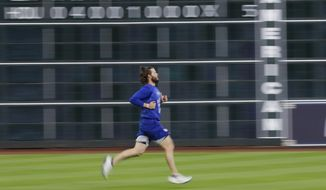 Los Angeles Dodgers' Clayton Kershaw runs before Game 4 of baseball's World Series against the Houston Astros Saturday, Oct. 28, 2017, in Houston. (AP Photo/David J. Phillip)