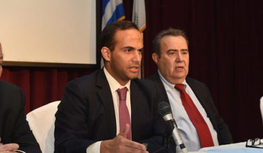 George Papadopoulos (left) was arrested in July and pleaded guilty in early October. (Associated Press/File)