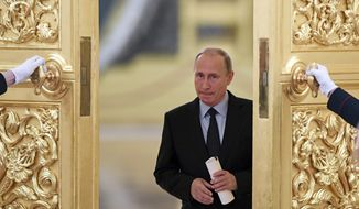 Russian President Vladimir Putin enters a hall to meet members of the Presidential Council for Civil Society and Human Rights at the Kremlin, in Moscow, Russia, Monday, Oct. 30, 2017. (Kirill Kudryavtsev/Pool photo via AP)