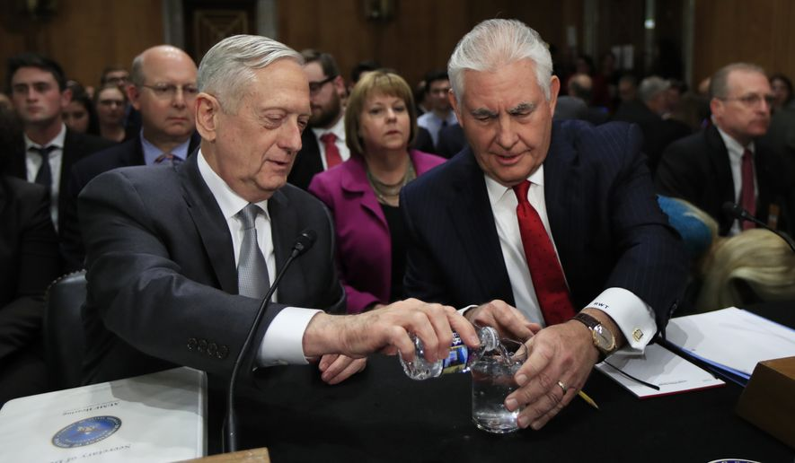 "Secretary of Defense Jim Mattis, left, pours drinking water for Secretary of State Rex Tillerson at the start of a Senate Foreign Relations Committee hearing on ""The Authorizations for the Use of Military Force: Administration Perspective"" on Capitol Hill in Washington, Monday, Oct. 30, 2017. (AP Photo/Manuel Balce Ceneta)"