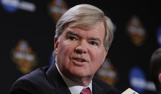FILE - In this March 30, 2017, file photo, NCAA President Mark Emmert answers a question at a news conference in Glendale, Ariz. Emmert said Monday, Oct. 30, major changes are needed in college basketball before next season to show the public that the NCAA is capable of governing the sport in the wake of a bribery scandal. (AP Photo/Matt York, File) **FILE**