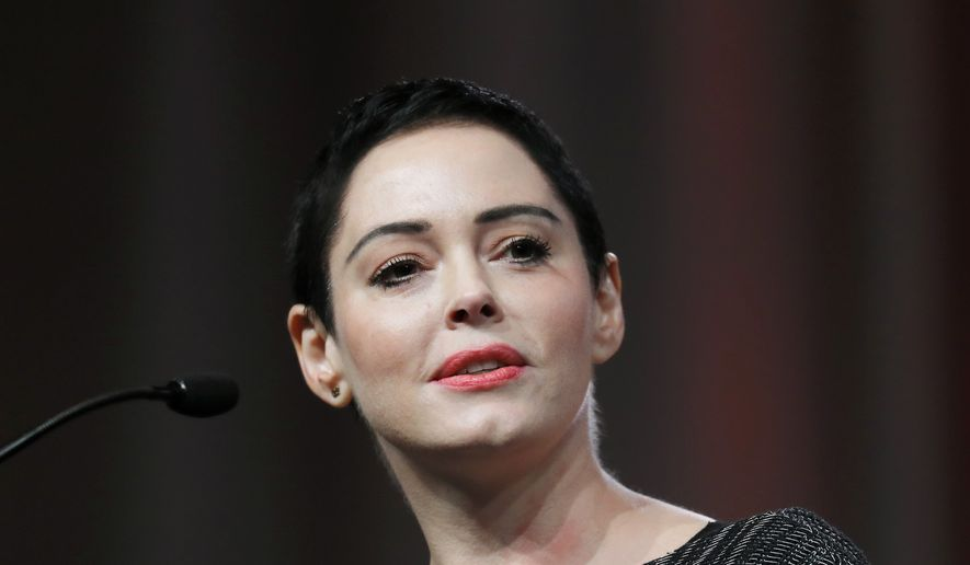 An arrest warrant has been obtained for Rose McGowan for felony possession of a controlled substance. The felony charge stems from a police investigation of personal belongings left behind on a United flight arriving at Washington Dulles International Airport on Jan. 20.  (AP Photo/Paul Sancya, File)
