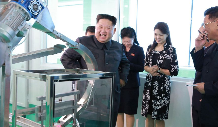 In this undated photo provided Sunday, Oct. 29, 2017, by the North Korean government,  North Korean leader Kim Jong-un, center, visits a cosmetics factory in Pyongyang, North Korea. At second from right is Kim's wife Ri Sol-ju. Independent journalists were not given access to cover the event depicted in this image distributed by the North Korean government. The content of this image is as provided and cannot be independently verified. (Korean Central News Agency/Korea News Service via AP)