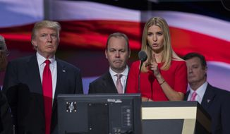 In this July 21, 2016, photo, then-Republican presidential candidate Donald Trump on stage with Rick Gates, center, and Ivanka Trump during a walk through at the Republican National Convention, Thursday, July 21, 2016, in Cleveland. At back right is then-Trump campaign chairman Paul Manafort. (AP Photo/Evan Vucci)