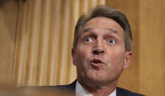 """Senate Foreign Relations Committee member Sen. Jeff Flake, R-Ariz., questions witnesses Secretary of State Rex Tillerson and Secretary of Defense Jim Mattis, during the committee's hearing on """"The Authorizations for the Use of Military Force: Administration Perspective"""" on Capitol Hill in Washington, Monday, Oct. 30, 2017. (AP Photo/Manuel Balce Ceneta)"""
