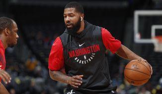 Washington Wizards forward Markieff Morris (5) in the first half of an NBA basketball game Monday, Oct. 23, 2017, in Denver. (AP Photo/David Zalubowski)