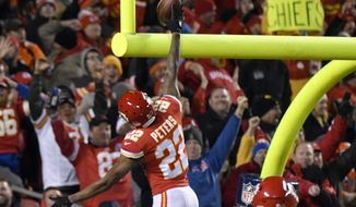 Kansas City Chiefs defensive back Marcus Peters (22) celebrates his touchdown after he stripped the ball from Denver Broncos running back Jamaal Charles (28), during the first half of an NFL football game in Kansas City, Mo., Monday, Oct. 30, 2017. Peters recovered the ball and ran for a touchdown. (AP Photo/Ed Zurga)