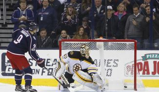 Columbus Blue Jackets' Artemi Panarin, left, of Russia, scores a goal against Boston Bruins' Tuukka Rask, of Finland, during the shootout period of an NHL hockey game Monday, Oct. 30, 2017, in Columbus, Ohio.  (AP Photo/Jay LaPrete)