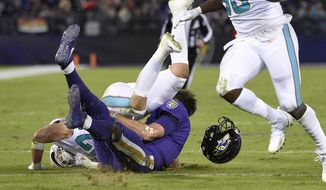 This Oct. 26, 2017 photo shows Miami Dolphins middle linebacker Kiko Alonso, top left, colliding with Baltimore Ravens quarterback Joe Flacco in the first half of an NFL football game in Baltimore. In their return from a three-day break, the Ravens provide an eagerly anticipated update on Flacco, who sustained a concussion in a 40-0 win over Miami and hopes to be ready for Sunday's game at Tennessee. (AP Photo/Nick Wass) **FILE**