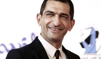 "In this Sept. 22, 2017 photo, Egyptian actor Amr Waked arrives on the red carpet during the first International El Gouna Film Festival, in the Red Sea resort of el-Gouna, Egypt. An Egyptian court has convicted actor Amr Waked of ""Salmon Fishing in the Yemen"" fame for damaging a car parked outside his Cairo home, sentencing him to three months in prison, his lawyer said on Monday, in a case suspected of serving as punishment for the actor's opposition to President Abdel-Fattah el-Sissi's rule. (AP Photo/Nariman El-Mofty)"