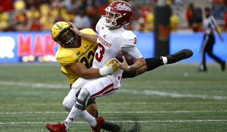 Maryland defensive lineman Chandler Burkett, left, sacks Indiana quarterback Peyton Ramsey in the first half of an NCAA college football game in College Park, Md., Saturday, Oct. 28, 2017. (AP Photo/Patrick Semansky)