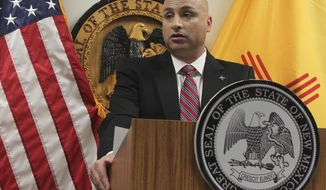 New Mexico Attorney General Hector Balderas discusses a settlement with one of the state's largest health insurance providers over unpaid premium taxes during a news conference Monday, Oct. 30, 2017, in Albuquerque, N.M. The New Mexico Attorney General's Office has reached an $18.5 million settlement with the state's largest health insurance provider over unpaid premium taxes. Prosecutors had accused a for-profit subsidiary of Presbyterian Healthcare Services of using an illegal accounting procedure to avoid paying taxes and surcharges on insurance premiums. Presbyterian says fraud allegations are dismissed under the settlement agreement. The deal was announced on Monday. (AP Photo/Susan Montoya Bryan)