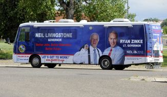 FILE - This July 14, 2011 file photo shows the campaign bus of then Montana gubernatorial candidate, Neil Livingstone, and his running mate, Ryan Zinke, in Great Falls, Montana. The Campaign Legal Center, a watchdog group, is accused Zinke and his dormant congressional campaign on Monday, Oct. 30, of skirting contribution laws when it sold the motor home to a friend of Zinke at a steep discount. (Rion Sander/The Great Falls Tribune via AP, File)