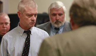 FILE - In this March 26, 2014, file photo, Craig Michael Wood, left, enters the courtroom for a hearing in Springfield, Mo. Wood is charged with first-degree murder, armed criminal action, child kidnapping, rape and sodomy in connection with 10-year-old Hailey Owens' death in February of 2014. Opening statements are set for Monday, Oct. 30, 2017. (Nathan Papes/The Springfield News-Leader via AP, Pool, File)
