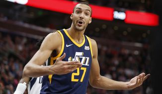 Utah Jazz center Rudy Gobert (27) has words with a official after he called for a foul against the Dallas Mavericks in the first half during an NBA basketball game Monday, Oct. 30, 2017, in Salt Lake City. (AP Photo/Rick Bowmer)
