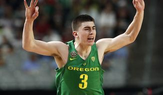 FILE - In this April 1, 2017, file photo, Oregon's Payton Pritchard reacts to a 3-point basket during the first half in the semifinals of the Final Four NCAA college basketball tournament against North Carolina in Glendale, Ariz. Pritchard is just a sophomore but for now he's charged with leading the Ducks following the departure of four starters. Oregon is in transition heading into the 2017-18 season, with just three returnees, a handful of freshman and two graduate transfers. (AP Photo/Charlie Neibergall, file)