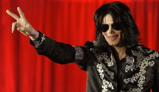 In this March 5, 2009, file photo, Michael Jackson appears at an event to announce a series of concerts in London. (AP Photo/Joel Ryan, File)