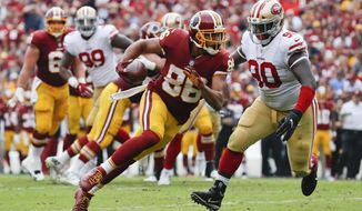 FILE - In this Sunday, Oct. 15, 2017 file photo, Washington Redskins tight end Jordan Reed (86) carries the ball during the first half of an NFL football game against the San Francisco 49ers in Landover, Md. Tight end Jordan Reed and defensive lineman Matt Ioannidis are among the injured Washington Redskins players who are expected to miss their upcoming game at the Seattle Seahawks on Sunday, Nov. 5, 2017. (AP Photo/Alex Brandon, File)