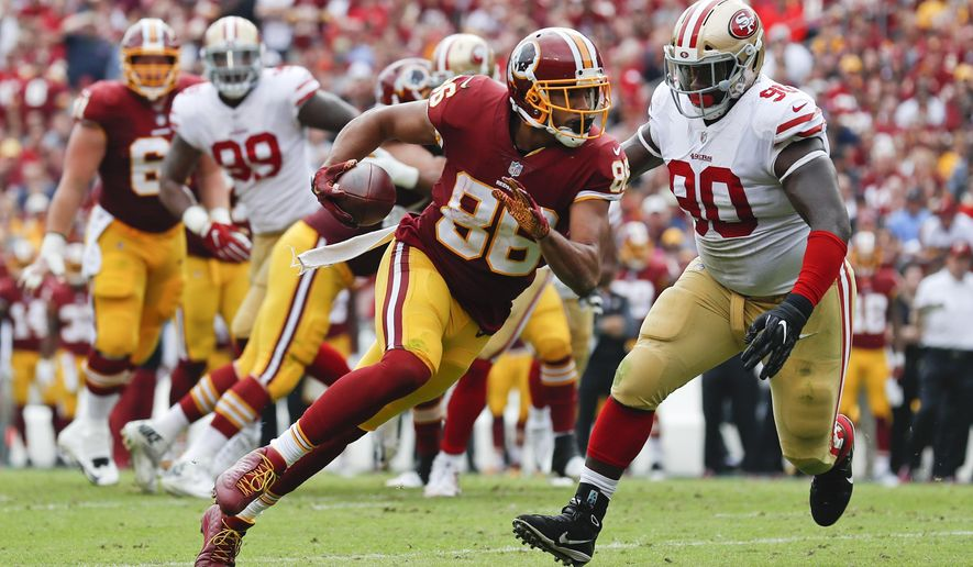 FILE - In this Sunday, Oct. 15, 2017 file photo, Washington Redskins tight end Jordan Reed (86) carries the ball during the first half of an NFL football game against the San Francisco 49ers in Landover, Md. Tight end Jordan Reed and defensive lineman Matt Ioannidis are among the injured Washington Redskins players who are expected to miss their upcoming game at the Seattle Seahawks on Sunday, Nov. 5, 2017. (AP Photo/Alex Brandon) ** FILE **