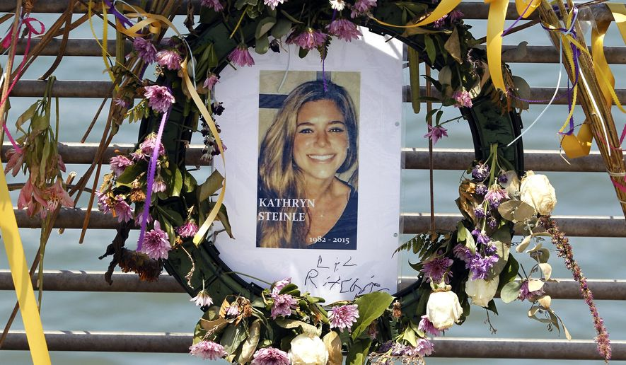 This July 17, 2015, file photo shows flowers and a portrait of Kate Steinle displayed at a memorial site on Pier 14 in San Francisco, Calif. The bullet that killed Kate Steinle two years ago ricocheted off the ground about 100 yards away before hitting her in the back and later launching a criminal case at the center of a national immigration debate. A San Francisco police officer who helped supervise the investigation testified about the bullet's trajectory Monday, Oct. 30, 2017 at Zarate's trial. (Paul Chinn /San Francisco Chronicle via AP, File) **FILE**