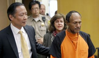 In this July 7, 2015, file photo, Jose Ines Garcia Zarate, right, is led into the courtroom by San Francisco Public Defender Jeff Adachi, left, and Assistant District Attorney Diana Garciaor, center, for his arraignment at the Hall of Justice in San Francisco. (Michael Macor/San Francisco Chronicle via AP, Pool, File)