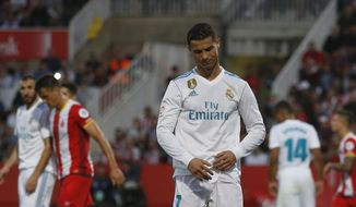 Real Madrid's Cristiano Ronaldo looks down after another attempt on goal during the La Liga soccer match between Girona and Real Madrid at the Montilivi stadium in Girona, Spain, Sunday, Oct. 29, 2017. (AP Photo/Manu Fernandez)