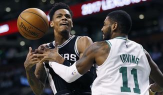 San Antonio Spurs' Dejounte Murray, left, loses control of the ball against Boston Celtics' Kyrie Irving, right, during the first quarter of an NBA basketball game in Boston, Monday, Oct. 30, 2017. (AP Photo/Michael Dwyer)