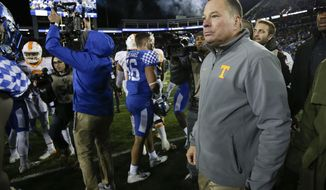 Tennessee head coach Butch Jones walks on the field after his team was defeated by Kentucky 29-26 in an NCAA college football game Saturday, Oct. 28, 2017, in Lexington, Ky. (AP Photo/David Stephenson)