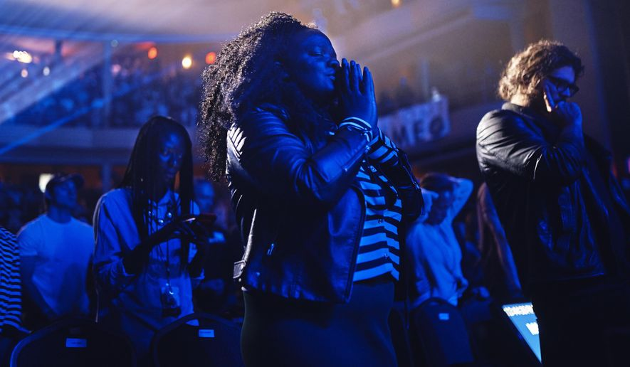 Whats up with bieber and his hillsong church pastor pal in this oct 22 2017 photo people pray during a service at hillsong malvernweather Choice Image