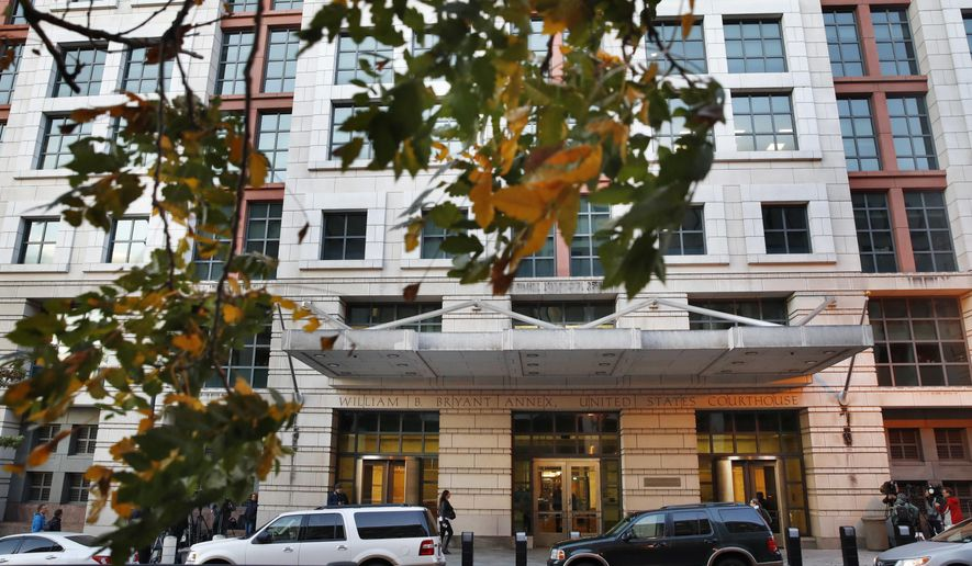Fall leaves blow on a tree across from the federal courthouse Monday, Oct. 30, 2017, in Washington. President Donald Trump's former campaign chairman, Paul Manafort, and a former business associate, Rick Gates, have been told to surrender to federal authorities Monday, according to reports and a person familiar with the matter.  (AP Photo/Jacquelyn Martin)