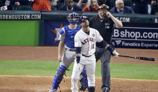 Houston Astros' Yuli Gurriel watches his three-run home run off Los Angeles Dodgers starting pitcher Clayton Kershaw during the fourth inning of Game 5 of baseball's World Series Sunday, Oct. 29, 2017, in Houston. (AP Photo/Charlie Riedel) **FILE**