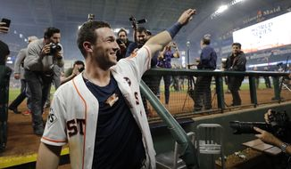 Houston Astros' Alex Bregman celebrates after hitting in the game-winning run during the 10th inning of Game 5 of baseball's World Series against the Los Angeles Dodgers Monday, Oct. 30, 2017, in Houston. The Astros won 13-12 to take a 3-2 lead in the series. (AP Photo/David J. Phillip)