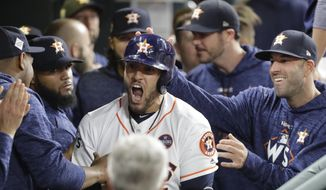 Houston Astros' George Springer celebrates his home run during the seventh inning of Game 5 of baseball's World Series against the Los Angeles Dodgers Sunday, Oct. 29, 2017, in Houston. (AP Photo/David J. Phillip)