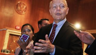 Internal Revenue Service (IRS) Commissioner John Koskinen talks to reporters on Capitol Hill in Washington, Wednesday, July 26, 2017 following his testimony before the Senate Appropriations subcommittee hearing on the fiscal 2018 federal budget. (AP Photo/Manuel Balce Ceneta)