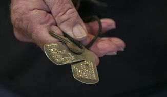 ADVANCE FOR USE SUNDAY, OCT. 29 On Oct. 10, 2017, veteran Tommy Swearingen donated dog tags to the LBJ Presidential Library. The dog tags did not belong to him. He discovered them in his belongings nearly 50 years after he was seriously wounded in the Vietnam War. The tags were stamped in capital letters with a name Swearingen did not recognize, D.A. JONES. Unable to find the original owner, the tags finally found a home about 19 months after his initial discovery. (Reshma Kirpalani/Austin American-Statesman via AP)