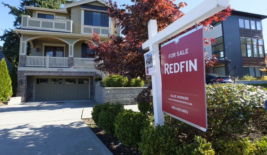 IMAGE DISTRIBUTED FOR REDFIN - A Redfin real estate yard sign is pictured in front of a house in Seattle on Tuesday, Oct. 24, 2017. (Stephen Brashear/AP Images for Redfin)