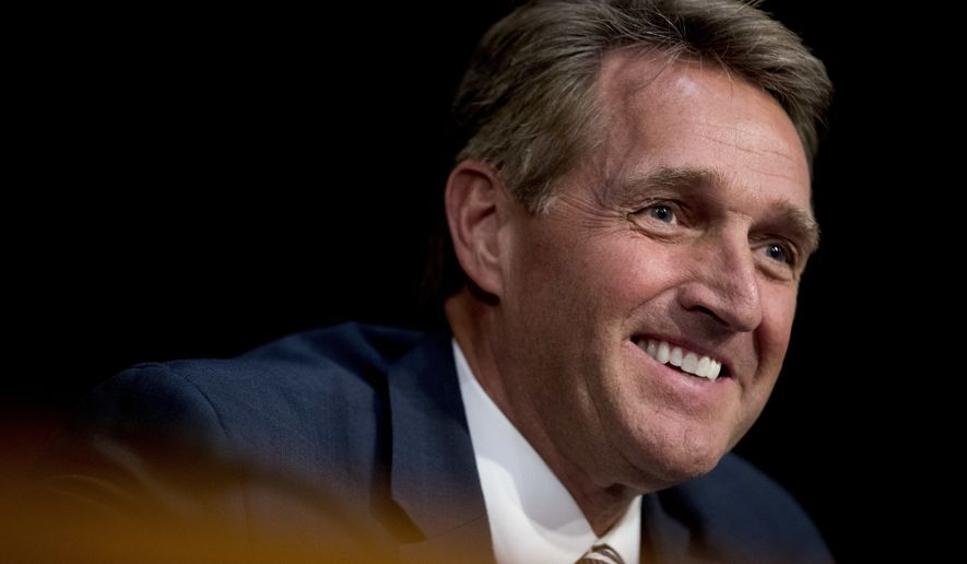 Sen. Jeff Flake, R-Ariz., smiles as he questions Facebook's General Counsel Colin Stretch, Twitter's Acting General Counsel Sean Edgett, and Google's Law Enforcement and Information Security Director Richard Salgado, as they testify during a Senate Committee on the Judiciary, Subcommittee on Crime and Terrorism hearing on Capitol Hill in Washington, Tuesday, Oct. 31, 2017, on more signs from tech companies of Russian election activity. (AP Photo/Andrew Harnik) ** FILE **
