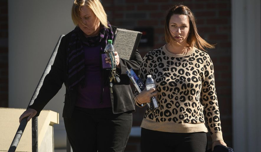 Shannon Allen, right, wife of Sgt. First Class Mark Allen, leaves the Fort Bragg Courtroom Facility after testifying at the Sgt. Bowe Bergdahl sentencing hearing on Monday, Oct. 30, 2017, on Fort Bragg, N.C. Sgt. First Class Mark Allen was critically injured during the search mission for Bergdahl. Bergdahl, who walked off his base in Afghanistan in 2009 and was held by the Taliban for five years, is charged with desertion and misbehavior before the enemy. (AP Photo/The Fayetteville Observer, Andrew Craft) ** FILE **