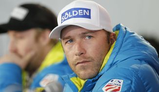 FILE - In this Monday, Feb. 2, 2015, file photo, USA men's ski team member Bode Miller participates in a news conference at the alpine skiing world championships, in Beaver Creek, Colo. Bode Miller is heading back to the Olympics. This time, he'll be calling the action from the TV booth. The six-time Olympic medalist, and only American to compete in Alpine skiing at five Winter Games, will work for NBC as an analyst alongside Dan Hicks at the Pyeongchang Games next February.  (AP Photo/Brennan Linsley, File)