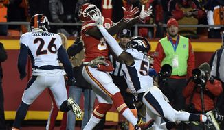 Kansas City Chiefs tight end Demetrius Harris (84) can't hold on to a pass while defended by Denver Broncos safety Darian Stewart (26) and linebacker Brandon Marshall (54), during the second half of an NFL football game in Kansas City, Mo., Monday, Oct. 30, 2017. The Chiefs won, 29-19. (AP Photo/Ed Zurga)